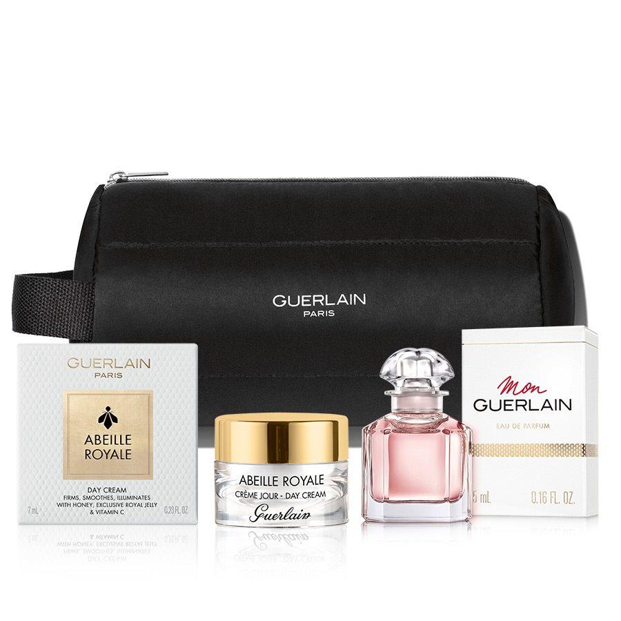 Guerlain Set (miniatúra parfumu Mon Guerlain, miniatúra denného krému z radu Abeille Royale a taštička Guerlain.)